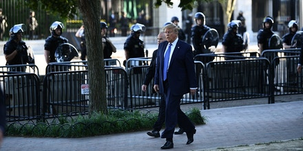 US President Donald Trump walks back to the White House after spending time in front of St. John's Episcopal church in Washington, DC on June 1, 2020 as police officers stand guard amid protests. - US President Donald Trump was due to make a televised address to the nation on Monday after days of anti-racism protests against police brutality that have erupted into violence.The White House announced that the president would make remarks imminently after he has been criticized for not publicly addressing in the crisis in recent days. (Photo by Brendan Smialowski / AFP) / ALTERNATE CROP (Photo by BRENDAN SMIALOWSKI/AFP via Getty Images)