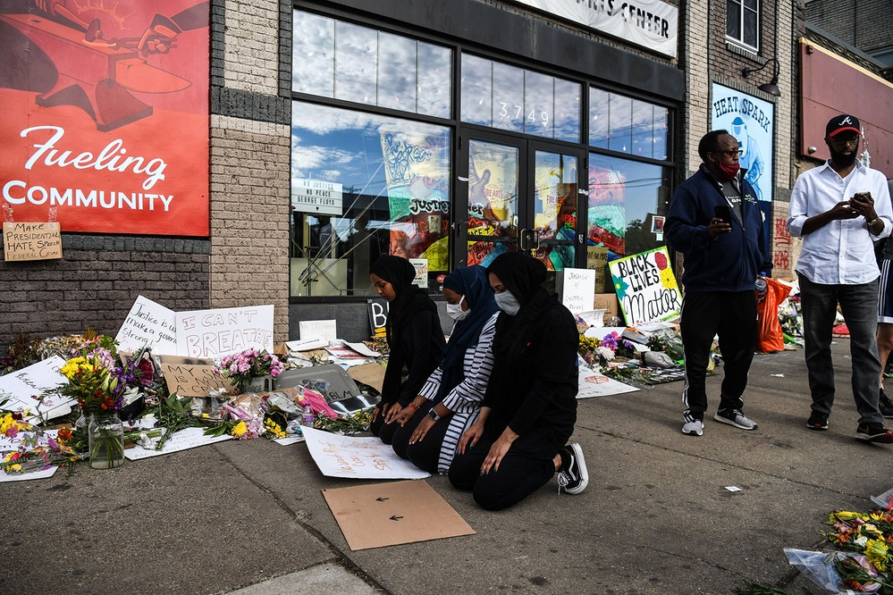 Muslim women offer evening prayers (namaz) at the makeshift memorial in honour of George Floyd, on June 4, 2020 in Minneapolis, Minnesota. - On May 25, 2020, Floyd, a 46-year-old black man suspected of passing a counterfeit $20 bill, died in Minneapolis after Derek Chauvin, a white police officer, pressed his knee to Floyd's neck for almost nine minutes. (Photo by CHANDAN KHANNA / AFP) (Photo by CHANDAN KHANNA/AFP via Getty Images)
