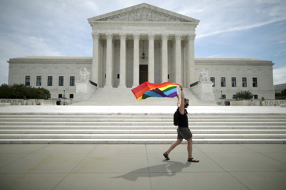WASHINGTON, DC - JUNE 15: Joseph Fons holding a Pride Flag, walks back and forth in front of the U.S. Supreme Court building after the court ruled that LGBTQ people can not be disciplined or fired based on their sexual orientation June 15, 2020 in Washington, DC. With Chief Justice John Roberts and Justice Neil Gorsuch joining the Democratic appointees, the court ruled 6-3 that the Civil Rights Act of 1964 bans bias based on sexual orientation or gender identity. (Photo by Chip Somodevilla/Getty Images)
