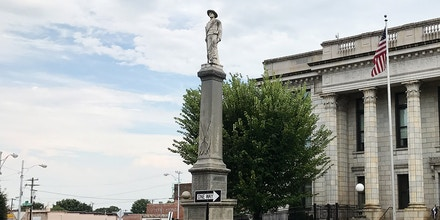 The Alamance County Confederate Monument, erected in 1914, is pictured  outside the historic courthouse in Graham, North Carolina, U.S. August 23, 2017.  County commissioners said this week they have no intention of seeking the monument's removal, despite such action taken in other cities and counties after the violence in Charlottesville.  Picture taken August 23, 2017.     REUTERS/Colleen Jenkins - RC1B197BC280