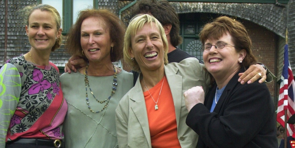 four women smiling together