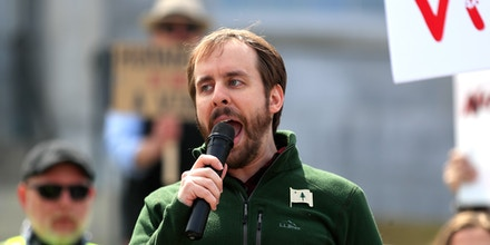 Eric Brakey, Republican candidate for Congress, speaks at an anti-stay-at-home protest on April 20, 2020, in Augusta, Maine.