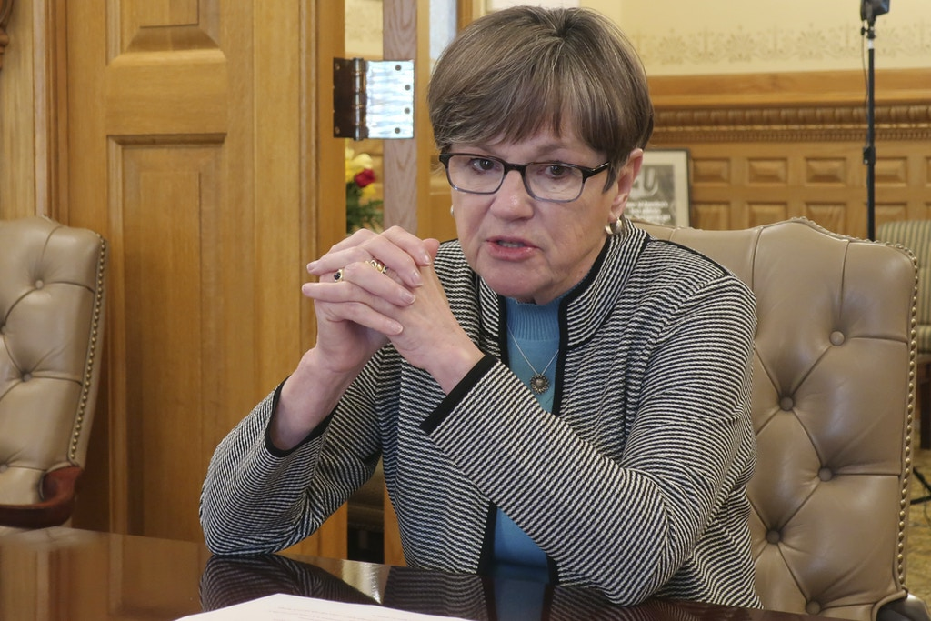 In this photo from Friday, May 1, 2020, Kansas Gov. Laura Kelly discusses the coronavirus pandemic and her plan to reopen the state's economy in an interview with The Associated Press at the Statehouse in Topeka, Kan. Most businesses in Kansas can reopen starting Monday, but operators of those left out of the initial phase are questioning why. (AP Photo/John Hanna)