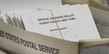 Box of Absentee Ballots waiting to be counted at the Albany County Board of Elections, Tuesday, June 30, 2020, in Albany, N.Y.