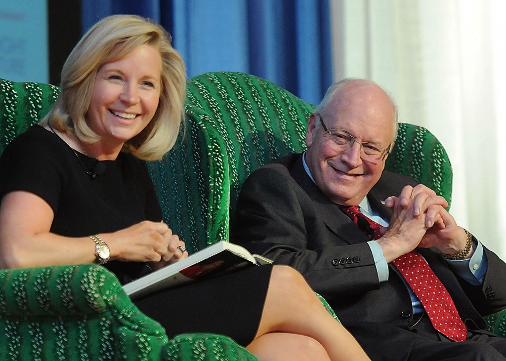 Former Vice President Dick Cheney, right, gestures as he speaks with his daughter Liz Cheney during the West Virginia Chamber of Commerce annual meeting held at The Greenbrier Resort in White Sulphur Springs. W.Va., Thursday Sept. 3, 2015. (Rick Barbero/The Register-Herald via AP) MANDATORY CREDIT