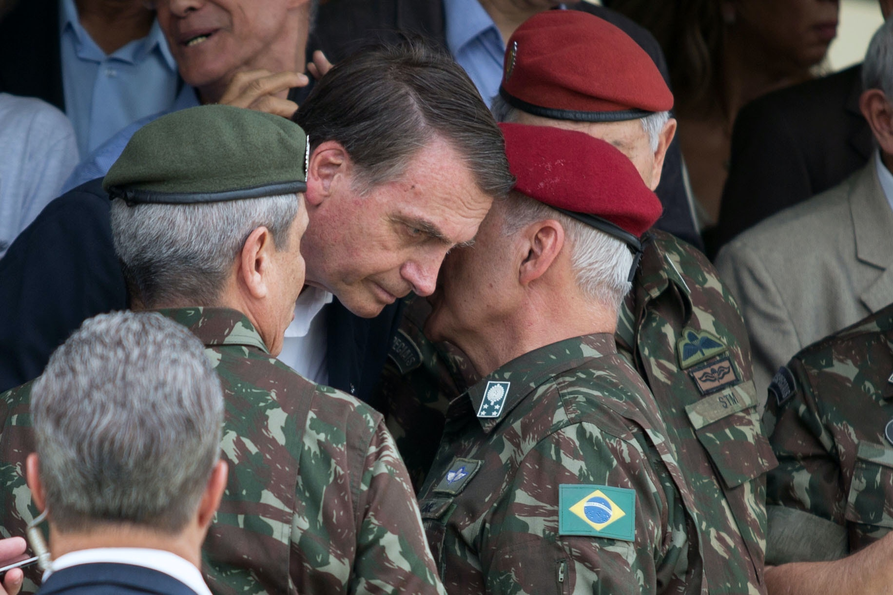 Brazilian Army General Luiz Eduardo Ramos Baptista Pereira (R) speaks to Brazilian President-elect Jair Bolsonaro (C), during the graduation ceremony of new paratroopers at the Parachute Infantry Battalion Vila Militar, in Rio de Janeiro, Brazil, on November 24, 2018. (Photo by Fernando Souza / AFP)        (Photo credit should read FERNANDO SOUZA/AFP via Getty Images)