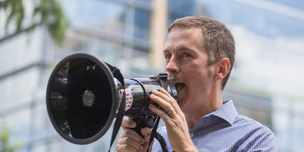 Mike Siegel, former public school teacher and civil rights lawyer running for Congress in the Texas's 10th District, speaks during a #CloseTheCamps protest in Austin, Texas, on July 2, 2019.