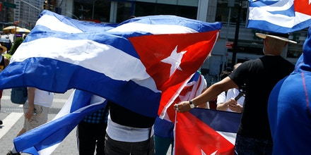 Demonstrators rally in Union Square against U.S. economic and travel sanctions against Cuba, in New York City on July 26, 2020.