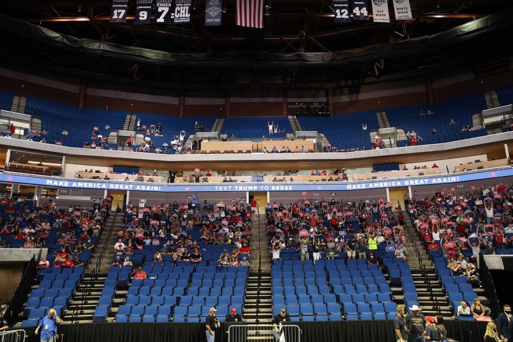 TULSA, OKLAHOMA - JUNE 20: Supporters wait for the start of a campaign rally for U.S. President Donald Trump at the BOK Center, June 20, 2020 in Tulsa, Oklahoma. Trump is holding his first political rally since the start of the coronavirus pandemic at the BOK Center on Saturday while infection rates in the state of Oklahoma continue to rise. (Photo by Win McNamee/Getty Images)