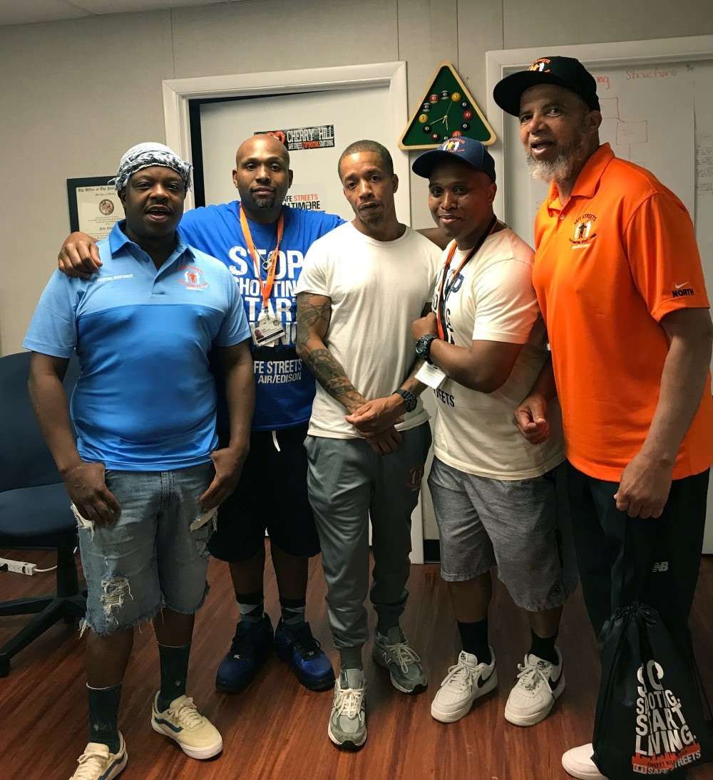 "Safe Streets workers, from left: ""Ice,"" a Cherry Hill hospital responder; Dante Barksdale, outreach coordinator; ""Reds"", another hospital responder; Elgin Maith, Director CHerry Hill Safe Streets; Denis Wise, former Director of Penn North Safe Streets."