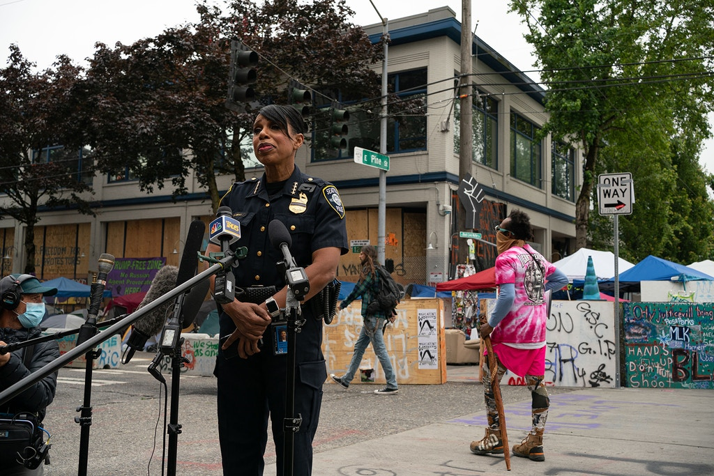 "SEATTLE, WA - JUNE 29: Seattle Police Chief Carmen Best holds a press conference outside of the departments vacated East Precinct in the area known as the Capitol Hill Organized Protest (CHOP) on June 29, 2020 in Seattle, Washington. The press conference was held near the site of an early morning shooting that left one person dead and one in critical condition. ""Enough is enough,"" she said. Four shootings in less than two weeks have taken place in the vicinity. (Photo by David Ryder/Getty Images)"