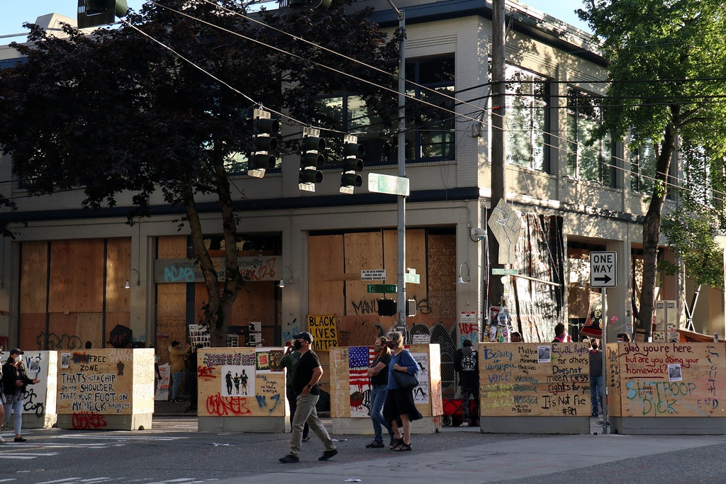 SEATTLE, WASHINGTON, UNITED STATES - 2020/06/18: Seattle's abandoned East Precinct police station is seen surrounded by barricades in the so-called Capitol Hill Autonomous Zone. An area in Seattle's Capitol Hill neighbourhood has become known variously as the Capitol Hill Occupied Protest or Capitol Hill Autonomous Zone since Mayor Jenny Durkan ordered the city's East Precinct police station to be evacuated and surrendered to protesters earlier this month. (Photo by Toby Scott/SOPA Images/LightRocket via Getty Images)