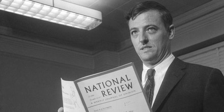 (Original Caption) Magazine editor William F. Buckley, Jr., editor of the National Review, holds a copy of the magazine as he makes a statement on the steps of the U.S. Courthouse. on the cover if the title of an article the magazine published,
