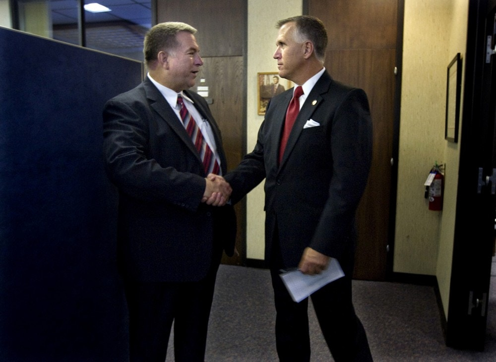 Newly elected Speaker of the North Carolina House of Rep. Thom Tillis, right, and newly elected Majority Leader Rep. Paul Stam, left, catch a quick moment together before leaving after a caucus, Saturday, Nov. 20, 2010, in Raleigh, N.C. Members of the Republican Caucus held named Tillis the new Speaker of the House and Stam the majority leader, among several positions they addressed. (AP Photo/News & Observer, Corey Lowenstein)