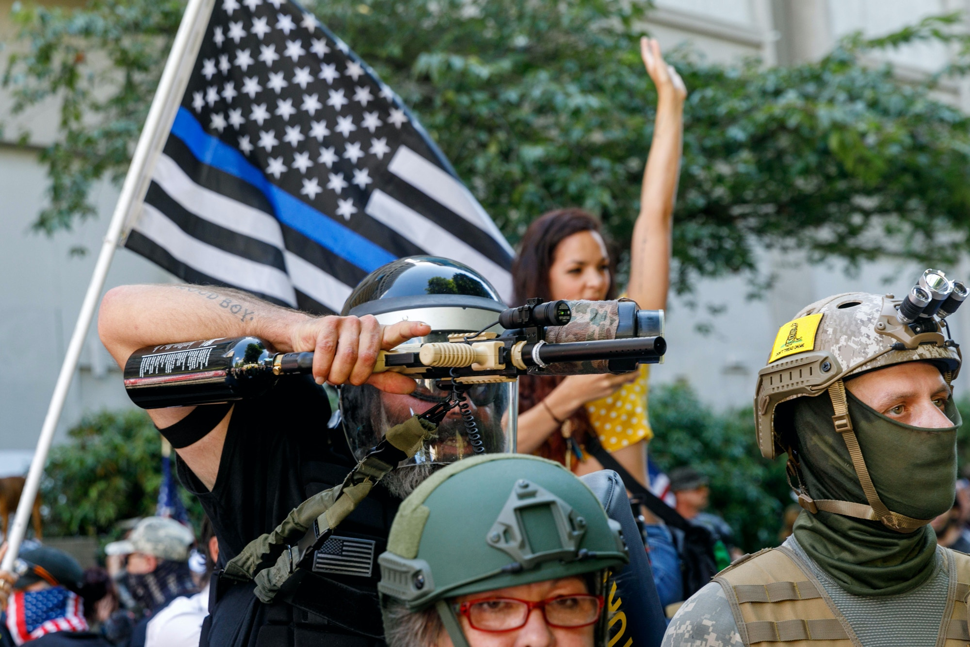 PORTLAND, OREGON, USA - AUGUST 22: Alan Swinney, a Proud Boy, fires sting-balls at counter-protesters as Right-wing demonstrators, many armed, clash violently with Black Lives Matter and Antifa counter-demonstrators, in Portland, Oregon, United States on August 22, 2020. (Photo by John Rudoff/Anadolu Agency via Getty Images)