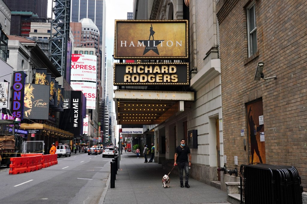 NEW YORK, NEW YORK - JUNE 29: A person walks a dog under the marquee of Hamilton: An American Musical at the Richard Rodgers Theatre on June 29, 2020 in New York City.  Broadway will remain closed until 2021 due to the ongoing coronavirus pandemic. (Photo by Cindy Ord/Getty Images)