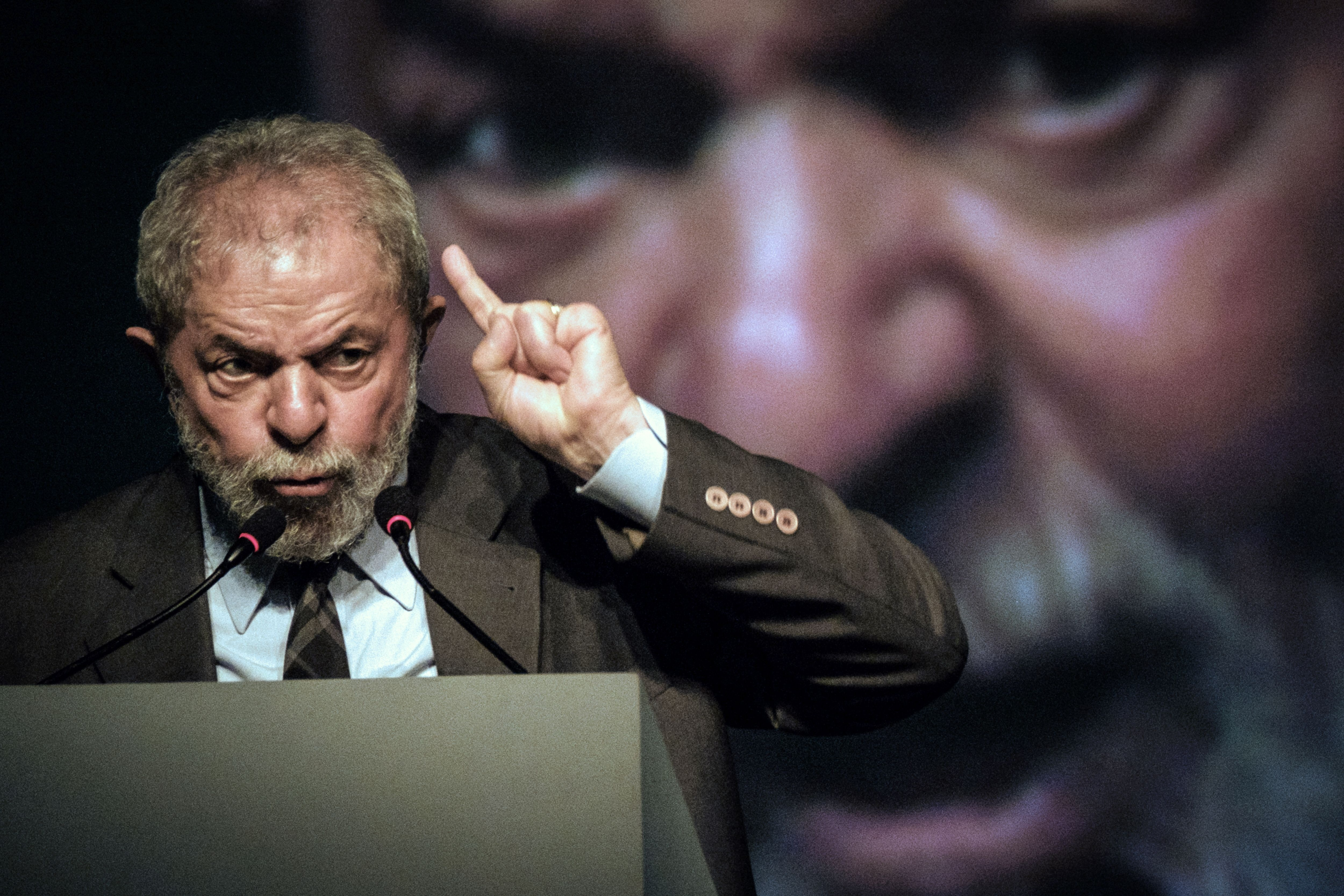 TOPSHOT - Brazil's former president (2003-2011) Luiz Inacio Lula da Silva speaks during the second congress of the IndustriALL Global Union in Rio de Janeiro, Brazil on October 4, 2016.IndustriALL Global Union represents workers in the mining, energy and manufacturing sectors in 140 countries around the world. / AFP / YASUYOSHI CHIBA (Photo credit should read YASUYOSHI CHIBA/AFP via Getty Images)