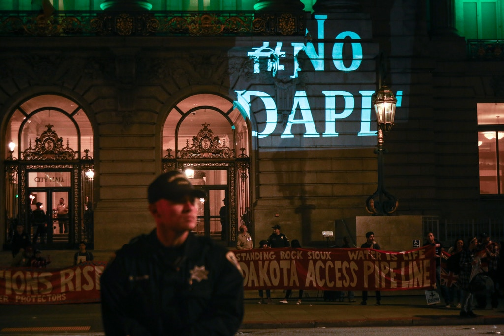 Protestors gather in front of City Hall during a protest in solidarity with the Standing Rock Sioux Tribe against the construction of the Dakota Access Pipeline, in San Francisco, on March 10, 2017.