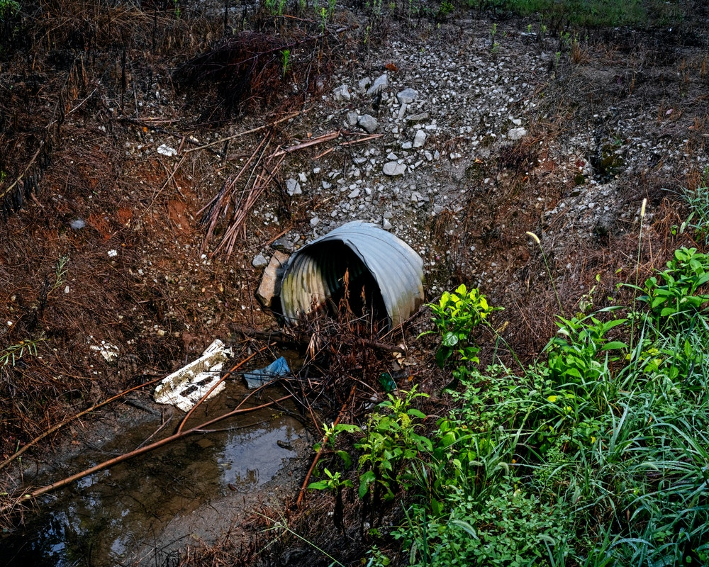 DECATUR, AL - August 20, 2020: A drainage ditch filled with trash  at the former Mud Tavern Landfill in DecaturCREDIT: Johnathon Kelso for The Intercept.