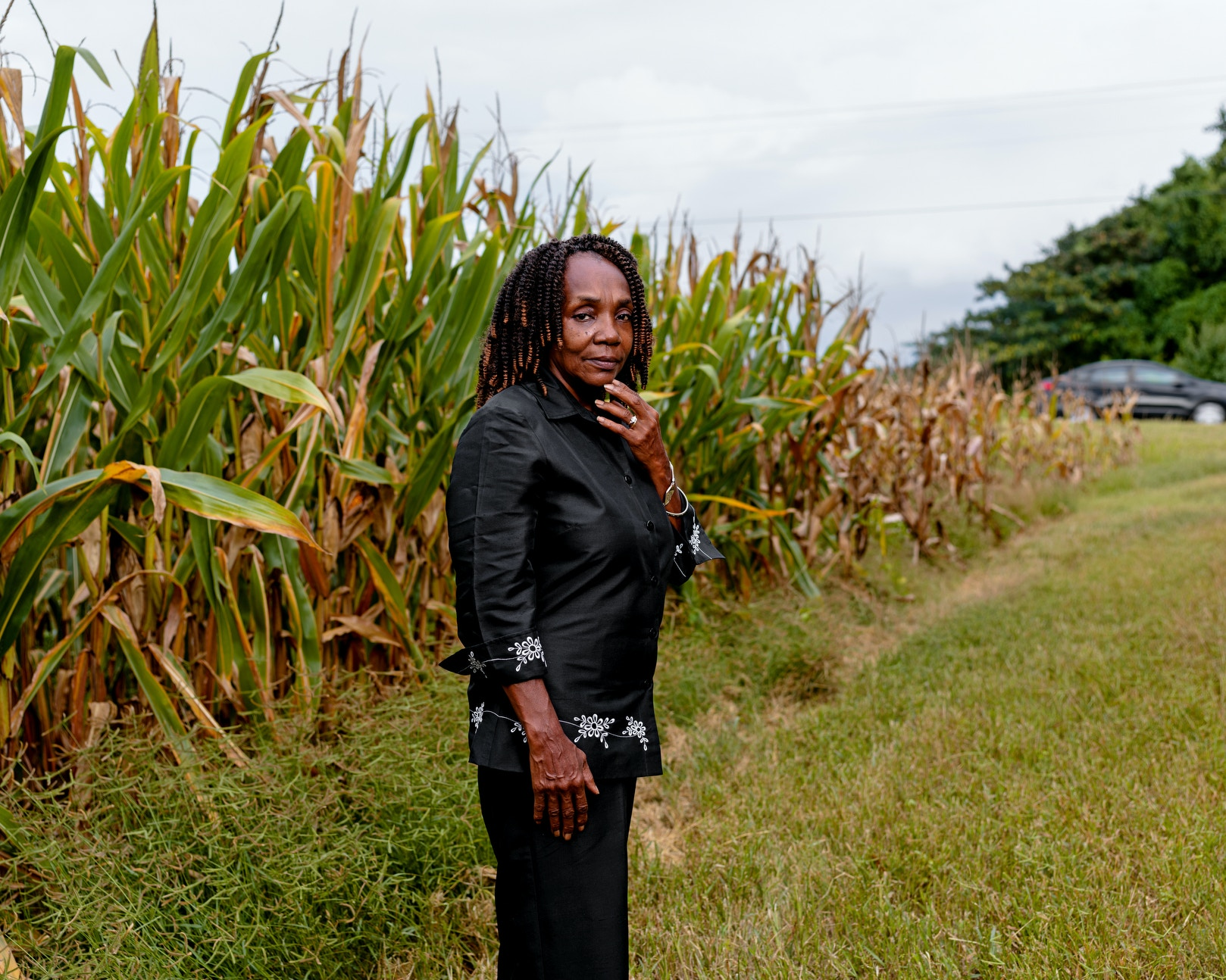 COURTLAND, AL - August 19, 2020: Brenda Hampton stands outside a corn field near her house in Courtlandl CREDIT: Johnathon Kelso for The Intercept.