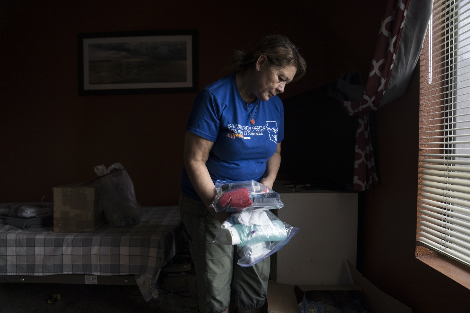 TUCSON, AZ - MARCH 13, 2020:Dora Rodriguez keeps donated items for asylum seekers in her home in Tucson, Arizona on March 13, 2020. She makes individual care packages from the donated items and then distributes them on a weekly basis to asylum seekers in Nogales, Mexico.In 1980 19-year-old Dora Rodriguez, from El Salvador, made the difficult journey of crossing into the US near Lukeville, AZ on foot. Of the 26 individuals she crossed the Sonoran desert with 13 died in the gruelling heat, one of the pre-eminent events that led to the Sanctuary Movement. Dora eventually naturalised in the US and started an advocacy group, Salvavision Rescue Arizona, to support asylum-seekers. On a weekly basis Dora visits asylum seekers in detention centres, writes them letters, fundraises and brings donated supplies to the migrant camps on the Mexican side of the US - Mexico border. Photo by Kitra Cahana/MAPS for The Intercept