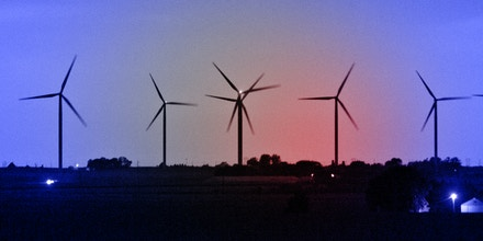 The silhouettes of wind turbines are seen standing at sunset on property used by EDP Renewables North America LLC Lost Lakes Wind Farm in Milford, Iowa, U.S., Sept. 15, 2016.
