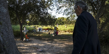 Ramiro Roberto Ramírez's walks into Eli Jackson Cemetery where his ancestors are buried in San Juan, Tex. on Nov. 6, 2018. The new proposed wall would leave this property on the south side of it.Photo: Verónica G. Cárdenas for The Intercept