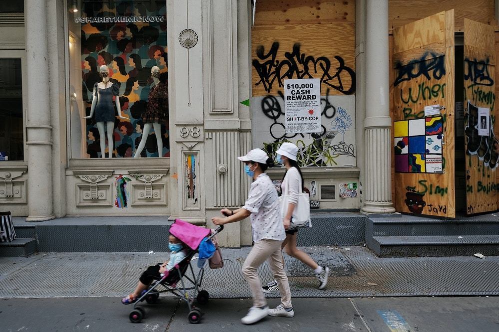 NEW YORK, NEW YORK - AUGUST 12: People walk past a closed business in a Manhattan shopping district on August 12, 2020 in New York City. Following a massive drop in tourism due to the Covid-19 pandemic and a work culture that increasingly keeps people at home, New York City is seeing a large exodus of chain stores and other retail businesses. Many of these businesses were struggling before the Covid outbreak due to the growing trend of online shopping and the situation has only worsened since. According to the commercial real estate services firm CBRE, average asking rents along 16 major retail areas in Manhattan have declined for the eleventh consecutive quarter.  (Photo by Spencer Platt/Getty Images)