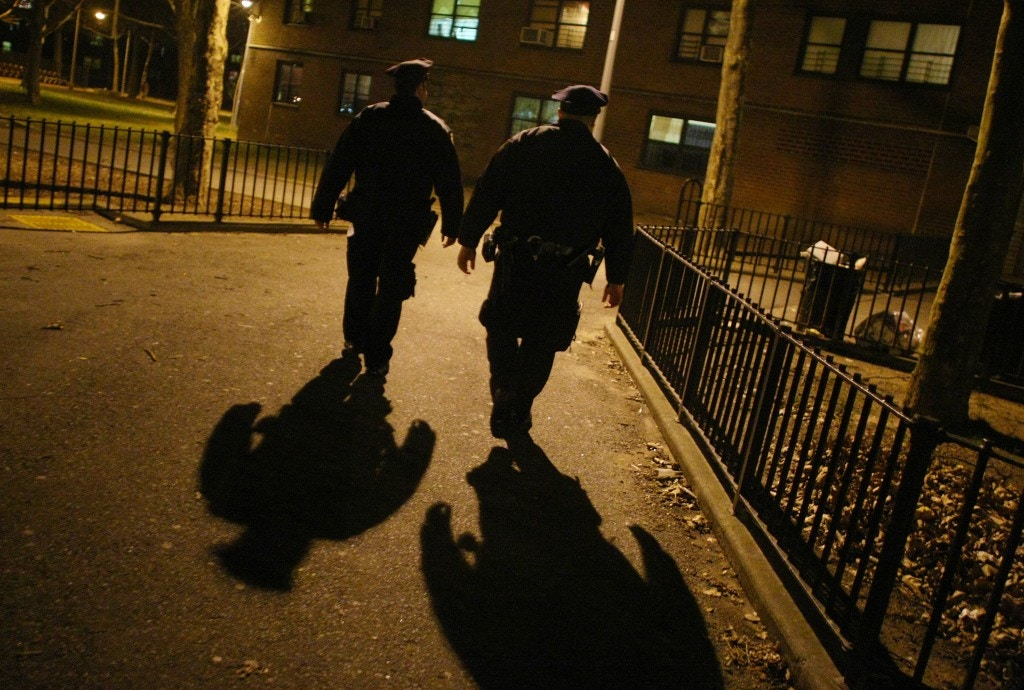 Officers Ian Gullo and Kevin Martinez patrol the Louis H. Pink Houses in Brooklyn, part of Operation Impact in the 75th Precinct on Dec. 18, 2008.