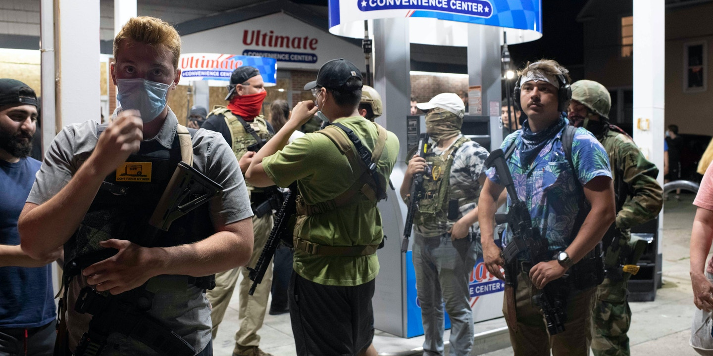 Armed civilians outside of a gas station during unrest in Kenosha, Wisconsin, August 25, 2020.
