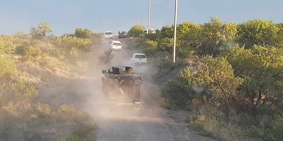 Border Patrol vehicles traveling on a dirt road in Arizona as part of a July 31, 2020, raid on the migrant humanitarian aid group No More Deaths