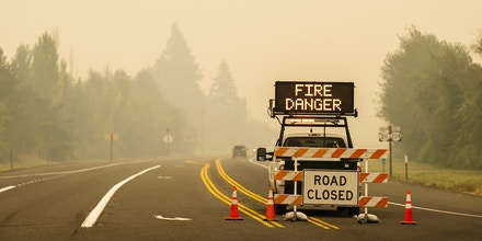 ESTACADA, OR - SEPTEMBER 10: A sign warning of impending fire danger is posted on September 10, 2020 in Estacada, Oregon. Multiple wildfires grew by hundreds of thousands of acres Thursday, prompting large-scale evacuations throughout the state.  (Photo by Nathan Howard/Getty Images)
