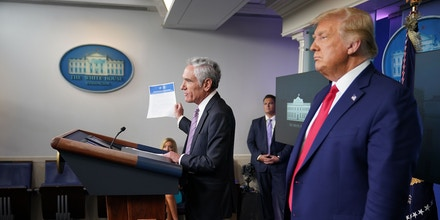 Senior Fellow at Stanford University's Hoover Institution Scott Atlas holds a Covid-19 vaccine playbook and distribution plan during a press conference with US President Donald Trump in the Brady Briefing Room of the White House on September 16, 2020, in Washington, DC. (Photo by MANDEL NGAN / AFP) (Photo by MANDEL NGAN/AFP via Getty Images)