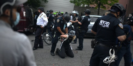 Protesters marching against police brutality are arrested by officers from the New York Police Department at 136th Street and Brook Avenue in the Bronx, NYC, on June 4, 2020.