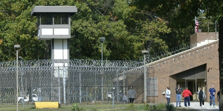 Employees walk in the yard at the Muskegon Correctional Facility on Oct. 4, 2012 in Muskegon, Mich.