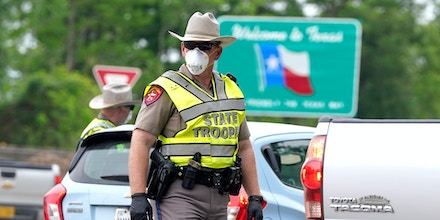 Texas Department of Public Safety State Troopers check motorists at a checkpoint in Orange, Texas, near the Louisiana state border, on April 6, 2020.