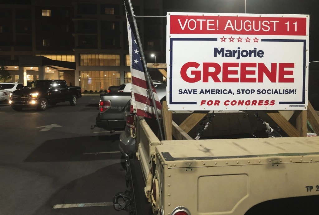 A sign showing support for Marjorie Taylor Greene, is seen on a vehicle outside an election watch event, late Tuesday, Aug. 11, 2020, in Rome, Ga.