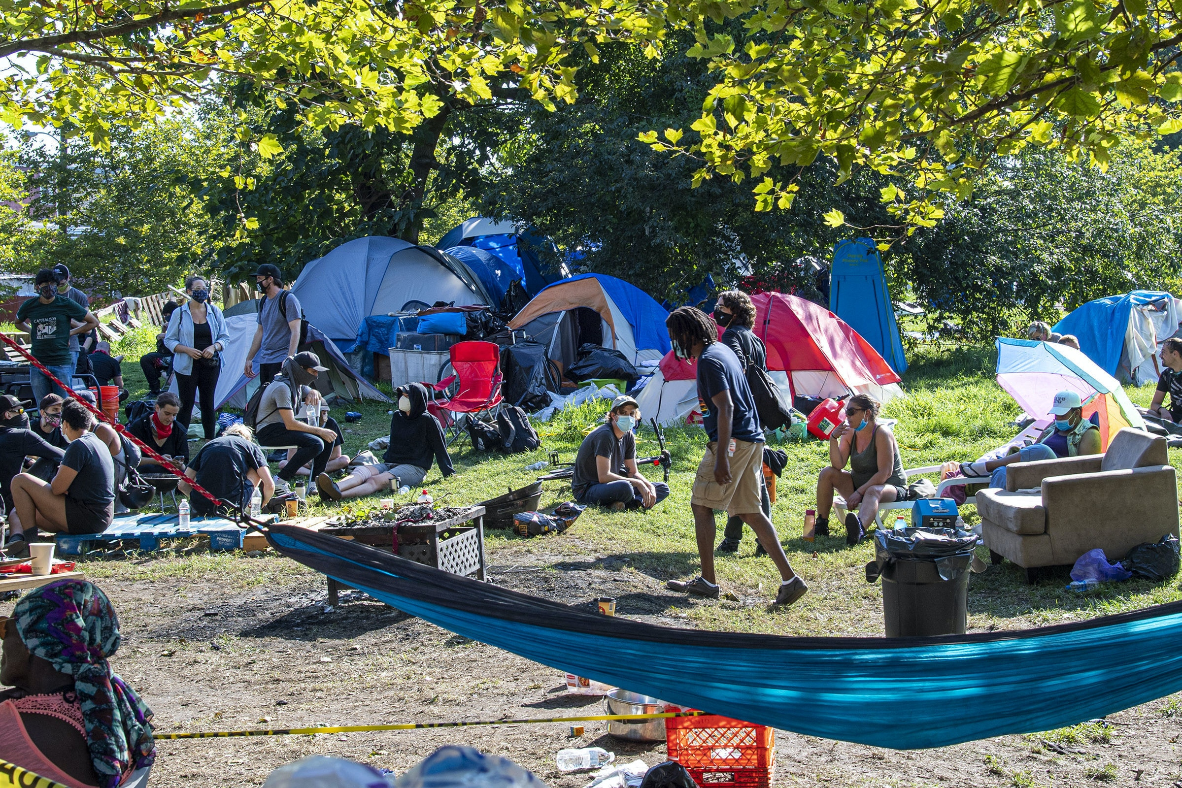 Activists and volunteers gather at a homeless encampment at Ridge Avenue and Jefferson Street in North Philadelphia on Aug. 18, 2020.