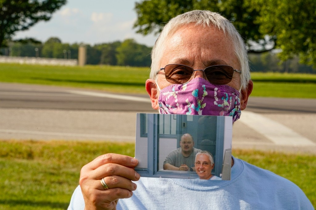 Sister Barbara Battista, holds a photo taken during her last visit with Keith Dwayne Nelson after Nelson was executed at the federal prison complex in Terre Haute, Ind., Friday, Aug. 28, 2020. Battista was Nelson's spiritual advisor and was present as he was executed. Nelson, who was convicted of kidnapping, raping and murdering at 10-year-old Kansas girl, was executed and pronounced death at 4:32pm. (AP Photo/Michael Conroy)