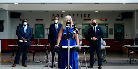 Philadelphia City Commissioner Lisa Deeley speaks during a news conference at the opening of a satellite election office.