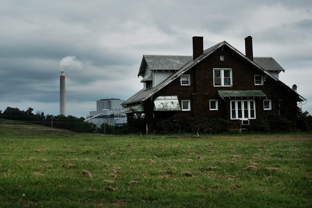 Home is seen with coal fire power plant behind it.