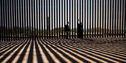 US Border Patrol Agents look at the border fence construction in the Organ Pipe Cactus National Monument.