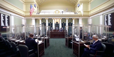 A full General Assembly returned to the Providence, RI House and Senate chambers after a hiatus due to the COVID-19, plexiglass is inserted between the senate chairs.