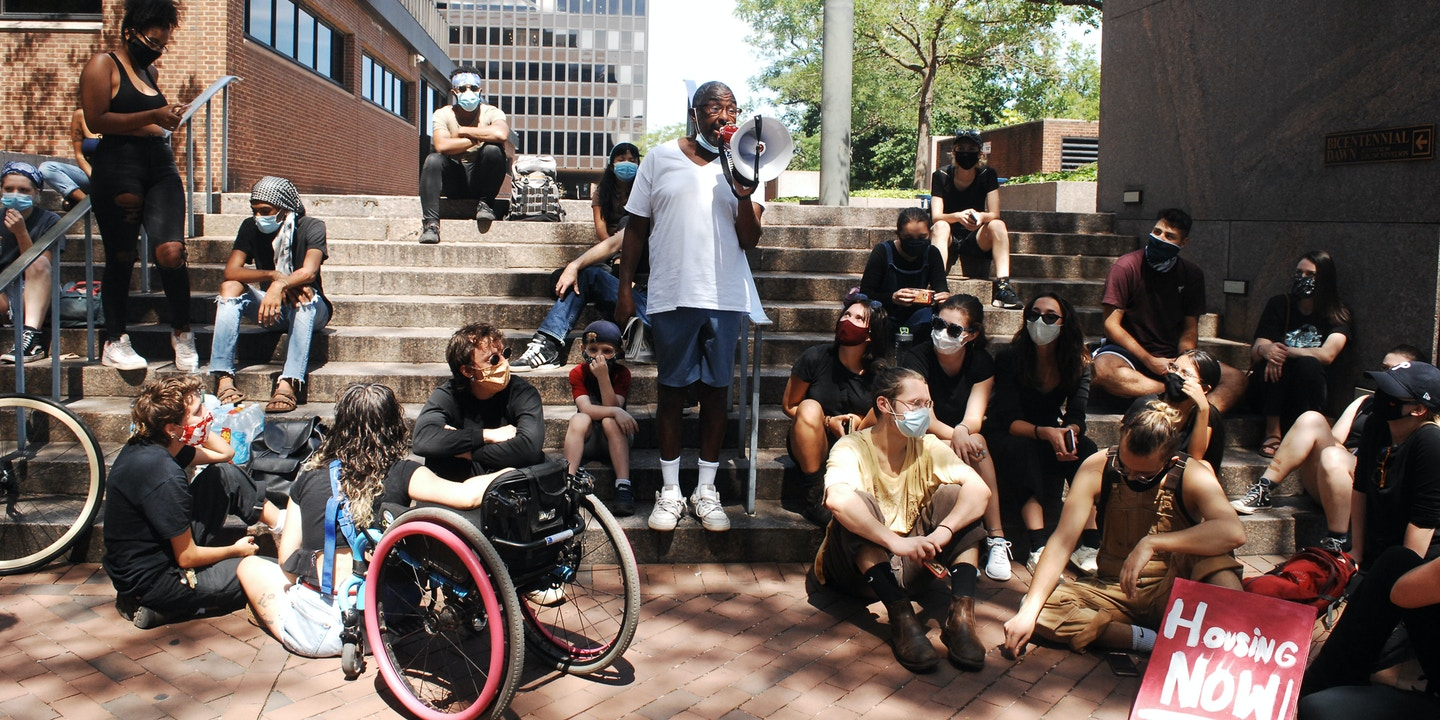 Housing Activists rallied in front of the courthouse in support of the camps before marching back to JTD Camp at 22nd street and the Benjamin Franklin Parkway in Philadelphia, PA on, August 20, 2020.
