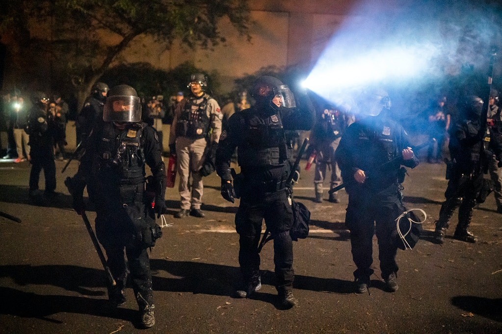 Portland police disperse a crowd of protesters on September 26, 2020 in Portland, Oregon.