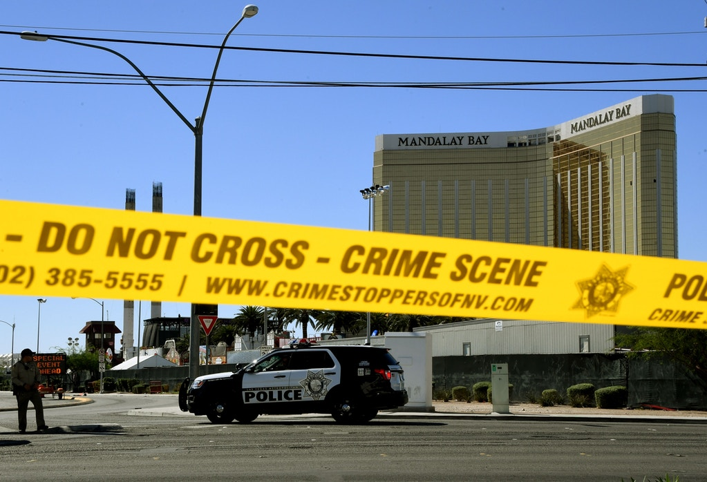 Crime scene tape surrounds the Mandalay Hotel on October 2, 2017 after Stephen Paddock killed at least 58 people and wounded more than 500 others when he opened fire a day earlier on a country music concert in Las Vegas. Police said the gunman, a 64-year-old local resident named as Stephen Paddock, had been killed after a SWAT team responded to reports of multiple gunfire from the 32nd floor of the Mandalay Bay, a hotel-casino next to the concert venue. / AFP PHOTO / Mark RALSTON (Photo credit should read MARK RALSTON/AFP via Getty Images)
