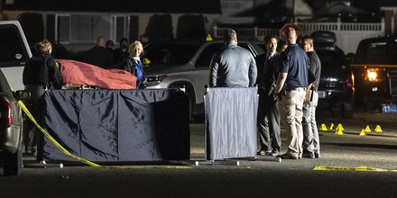 LACEY, WA - SEPTEMBER 03: Investigators move the body of a man who is reportedly Michael Forest Reinoehl after he was shot and killed by law enforcement on September 3, 2020 in Lacey, Washington. Reinoehl was being investigated by law enforcement for his role in a fatal shooting at a pro-trump rally in Portland on Saturday. (Photo by Nathan Howard/Getty Images)