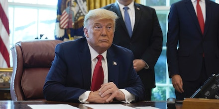 President Donald Trump listens while on a phone call with leaders of Sudan and Israel in the Oval Office of the White House, Friday, Oct. 23, 2020, in Washington. Secretary of State Mike Pompeo and Jared Kushner listen. (AP Photo/Alex Brandon)