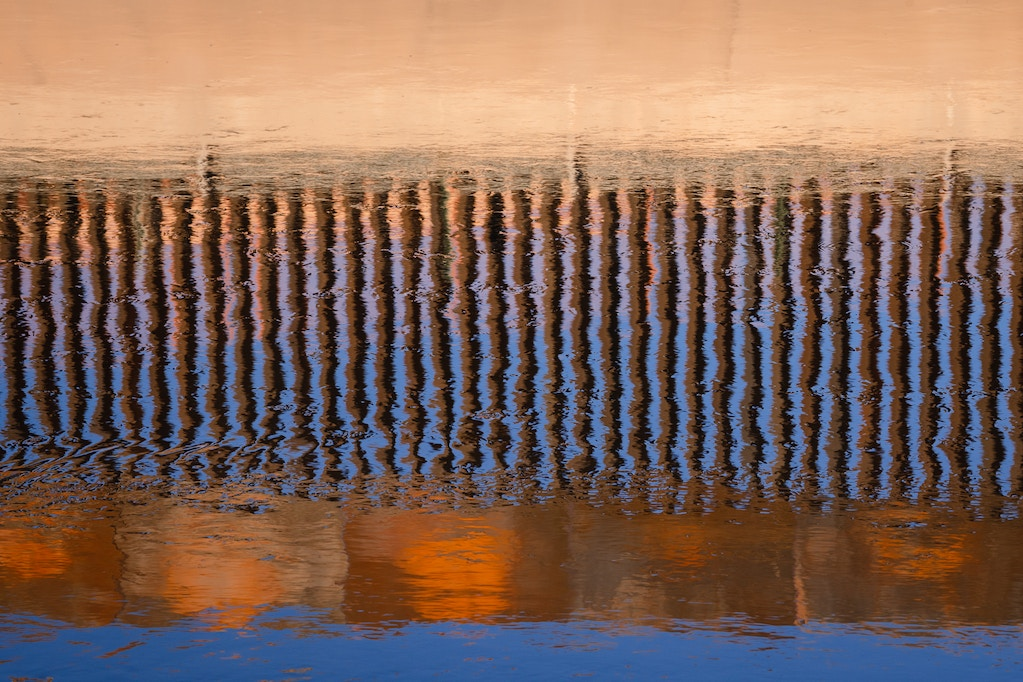 The border fence reflected in the Rio Grande from Ciudad Juárez, Mexico. October 29, 2020.