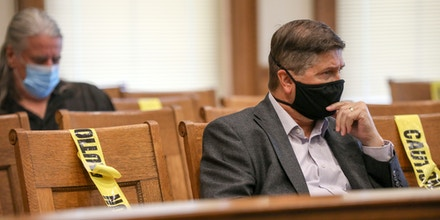 Linn County Auditor Joel Miller listens at a hearing at the Johnson County Courthouse.